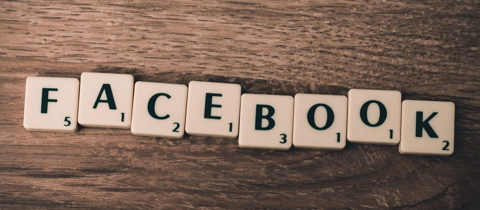 Scrabble tiles spelling Facebook